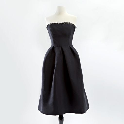 Black silk faille strapless cocktail dress with full skirt and organza ruffle across bodice