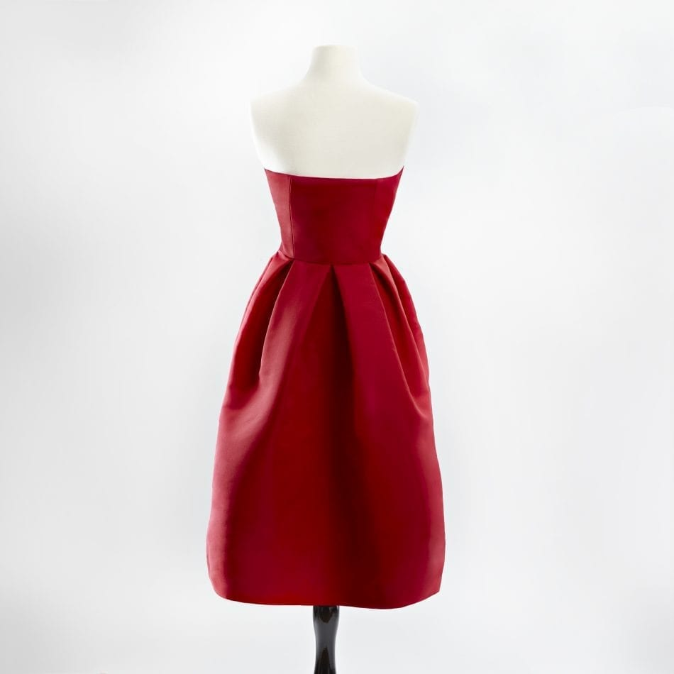 Red strapless silk faille cocktail dress with a full skirt back view