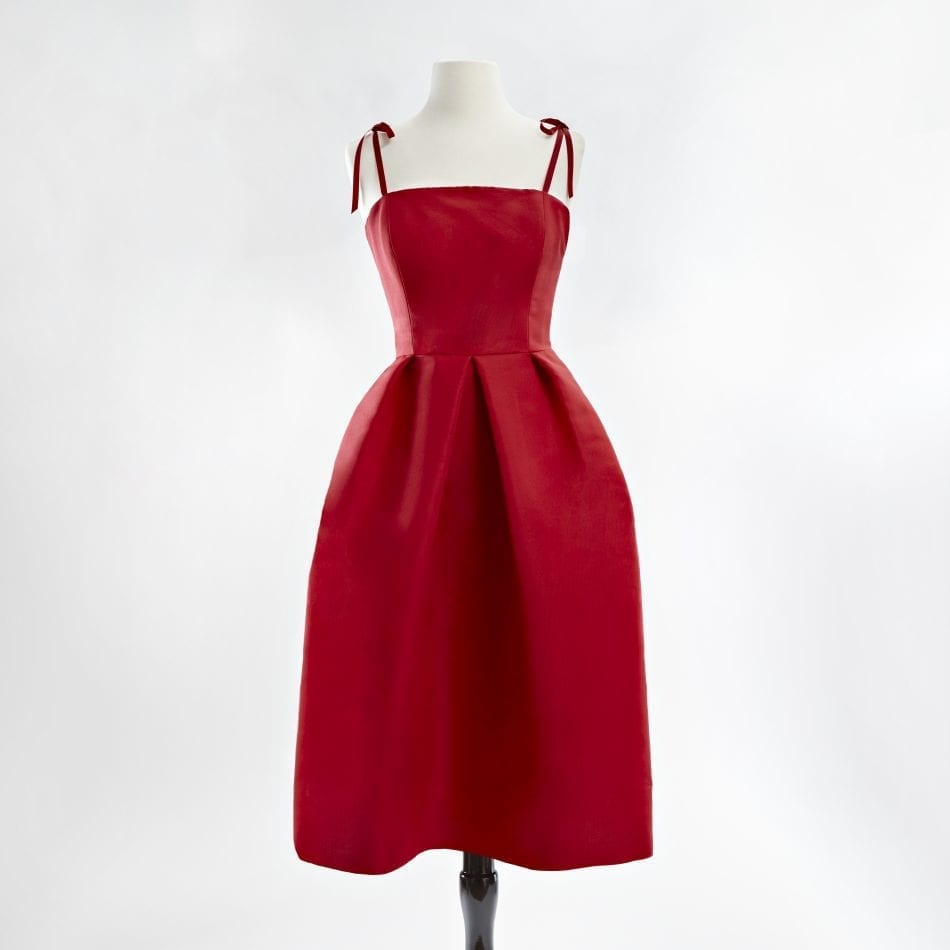Red silk faille dress with tie able ribbon straps and a full skirt