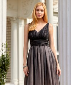 Model wearing black silk organza v-neck cocktail dress with full skirt standing