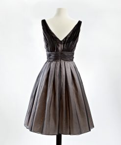 Black silk organza v-neck cocktail dress with full skirt and pink taffeta underskirt back view