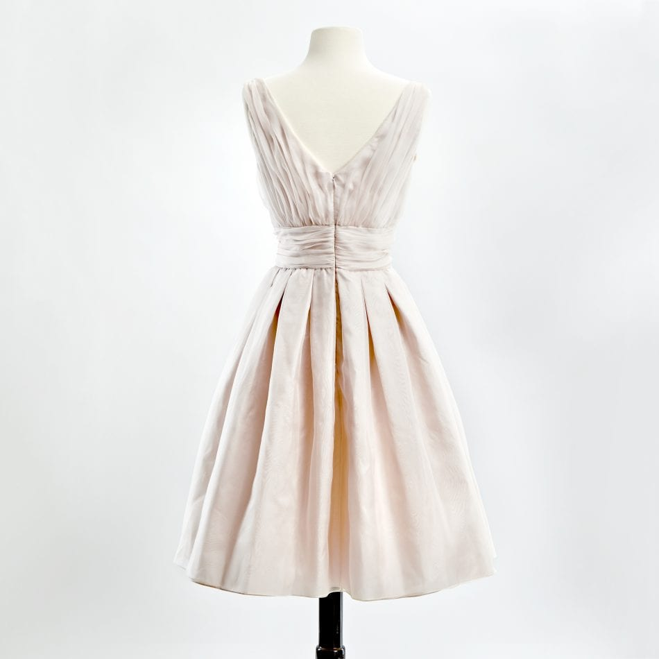 Blush silk organza v-neck cocktail dress with full skirt back view