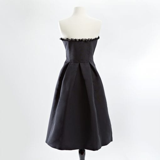 Black strapless silk faille cocktail dress with organza ruffle and full skirt back view